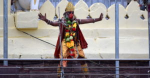 A-besadhari-in-the-form-of-Lord-Hanuman-entertains-the-people-just-below-the-Snana-Mandap