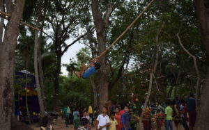 A-boy-on-the-original-bamboo-swing-at-Naiguan-Village-Salepur