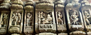 Carvings-depicting-way-of-Life-lady-holding-purse-and-the-Kings-durbar-at-Sobhaneswara-Temple-Niali